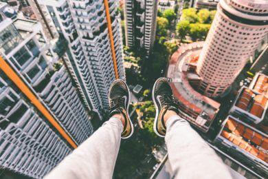 feet dangling off building jealous boyfriend