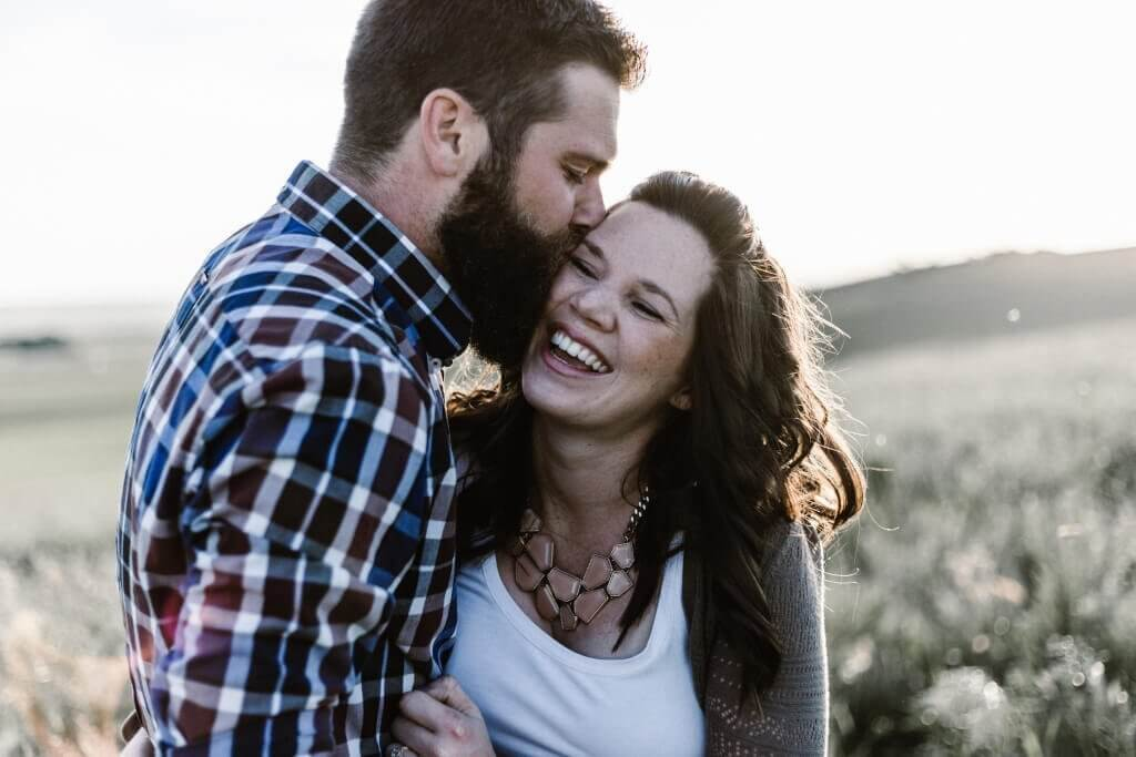 man kissing wife struggling with wife's past